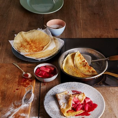 Crepe style pancakes with roast rhubarb and rosewater compote