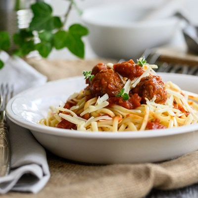 Oven baked meatballs with red sauce, linguini and hard cheese