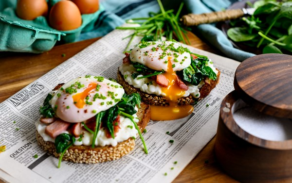 Poached eggs on toasted village bread with sautéed baby spinach, rucola, 'singlino' from Mani and cottage cheese