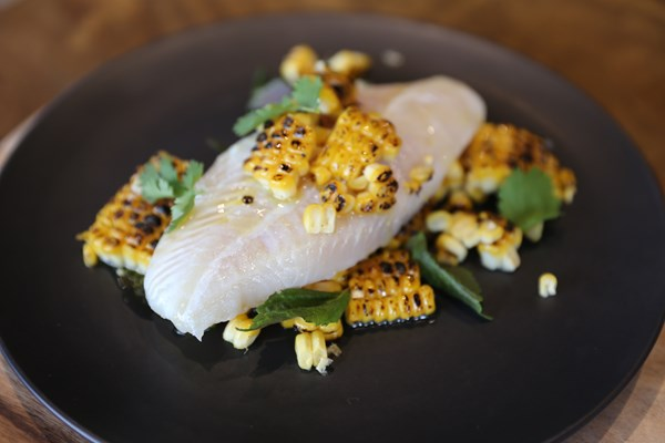 BUTTER POACHED FISH SERVED WITH BUTTER CHARRED CORN