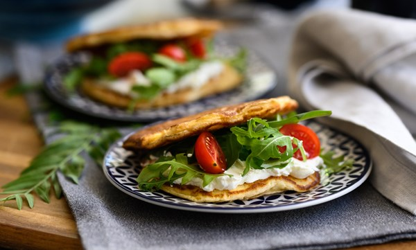 Stuffed savoury pancakes with mozzarella, smoked pork leg and cherry tomatoes
