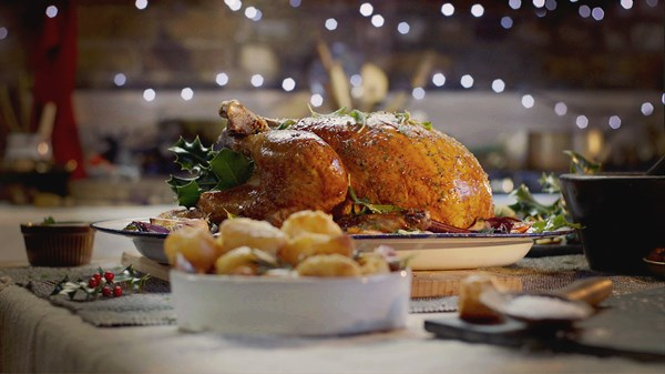Herb buttered turkey with walnut and cranberry stuffing