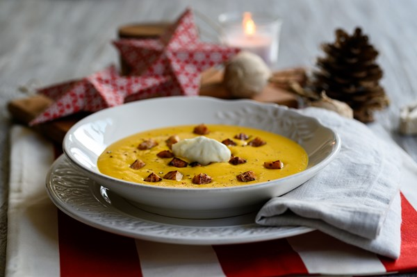 Christmas velouté soup with posyrti and cream cheese flavoured with citrus fruit