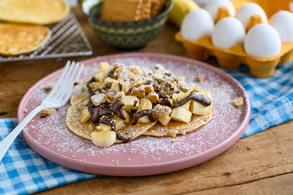 Pancakes with chocolate, banana and biscuits